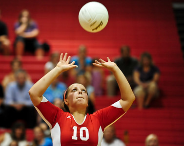 Josh Peckler - Jpeckler@shawmedia.com Dundee-Crown's Cori Eischen prepares to set the ball during the 2nd game against Streamwood at Dundee-Crown High School Wednesday, August 22, 2012. Dundee-Crown won the match 2-1.