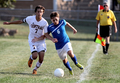 Sarah Nader - snader@shawmedia.com Crystal Lake Central's Matthew Ferris (left) and Dundee-Crown's Alex Ramirez try to keep the ball in bounds during the first half of Tuesday's game in Crystal Lake on August 28, 2012. Dundee-Crown won, 3-0.