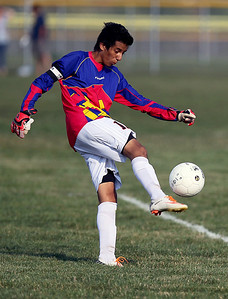 Sarah Nader - snader@shawmedia.com Crystal Lake Central's goalie Luis Medina kicks the ball to his teammates during the first half of Tuesday's game against Dundee-Crown in Crystal Lake on August 28, 2012. Dundee-Crown won, 3-0.