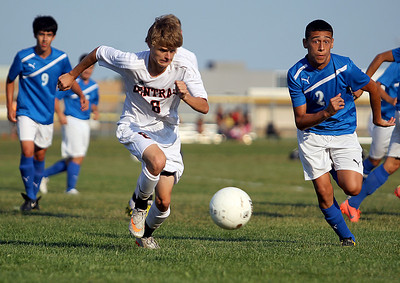 Sarah Nader - snader@shawmedia.com Dundee-Crown's Franco Nestor (right) races up to Crystal Lake Central's Scott Benhart as he brings the ball down field during the first half of Tuesday's game in Crystal Lake on August 28, 2012. Dundee-Crown won, 3-0.