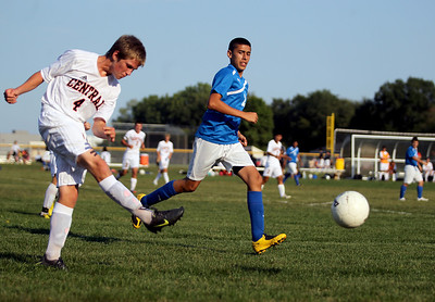 Sarah Nader - snader@shawmedia.com Dundee-Crown's Franco Nestor (right) races up to Crystal Lake Central's Scott Benhart as he kicks the ball down field during the first half of Tuesday's game in Crystal Lake on August 28, 2012. Dundee-Crown won, 3-0.