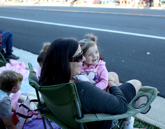 Nicole Fanucchi and her daughter, Lianna, 1, wait for the Elburn Days Parade to begin on Main Street in downtown Elburn Friday evening. The Elburn Days festival runs through Sunday. (Sandy Bressner photo)