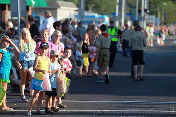 Children watch as the Elburn Days Parade makes its way down Main Street in downtown Elburn Friday evening. The Elburn Days festival runs through Sunday. (Sandy Bressner photo)
