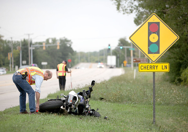 Kane County Sheriff's officials investigate a fatal motorcycle crash involving a semi on Kirk Road near Cherry Lane in Geneva. (Sandy Bressner photo)