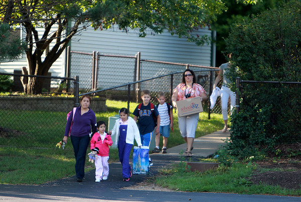 Students arrive for their first day of school at Fox Ridge Elementary School in St. Charles Wednesday morning.