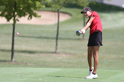 Mike Greene - mgreene@shawmedia.com Huntley's Zoe Dowell tees off on the 12th hole during a season-opening event hosted by Huntley High School Tuesday, August 14, 2012 at Pinecrest Golf and Country Club in Huntley.  Huntley took second place overall in the event, with Crystal Lake Central taking first place.
