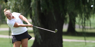 Mike Greene - mgreene@shawmedia.com Dundee-Crown's Alexis Howe tees off on the 11th hole during a season-opening event hosted by Huntley High School Tuesday, August 14, 2012 Pinecrest Golf and Country Club in Huntley. Crystal Lake Central took first place overall in the event.