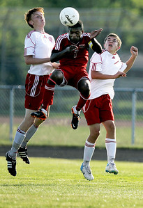 Sarah Nader - snader@shawmedia.com Marian Central's Riley Blaz (left) and Huntley's Lucas Baker jump for the ball during the second half of Thursday's game in Woodstock on Thursday, August 23, 2012.