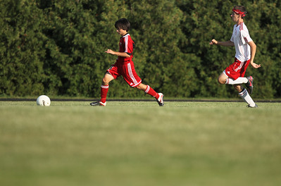 Sarah Nader - snader@shawmedia.com Huntley's Aaron Koterbski (left) brings the ball toward the goal during the first half of Thursday's game against Marian Central in Woodstock on Thursday, August 23, 2012.