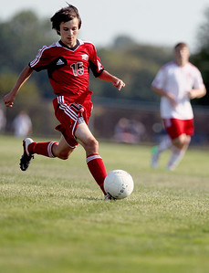 Sarah Nader - snader@shawmedia.com Huntley's Aaron Koterbski kicks the ball down field during the first half of Thursday's game against Marian Central in Woodstock on Thursday, August 23, 2012.