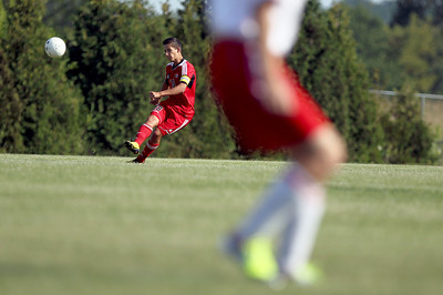 Sarah Nader - snader@shawmedia.com Huntley's Jakub Rys kicks  the ball down field during the first half of Thursday's game against Marian Central in Woodstock on Thursday, August 23, 2012.