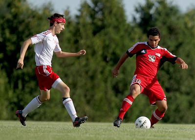 Sarah Nader - snader@shawmedia.com Huntley's Niko Mihalopoulos (right) kicks the ball down field during the first half of Thursday's game against Marian Central in Woodstock on Thursday, August 23, 2012.