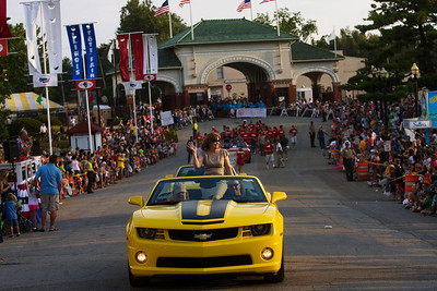 Grand Marshall and 2011 Illinois Teacher of the Year Annice Brave waves to the crowd as she makes her way through the fairgrounds during the 2012 Illinois State Fair Twilight Parade. (AP Photo/Ted Schurter, The State Journal-Register)