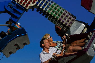 Visitors to the Illinois State Fair enjoy the amusement rides in Springfield, Ill. Unexpected mild temperatures this week will help attendance after a summer heat wave across the country kept a lot of people inside. (AP Photo/Seth Perlman)
