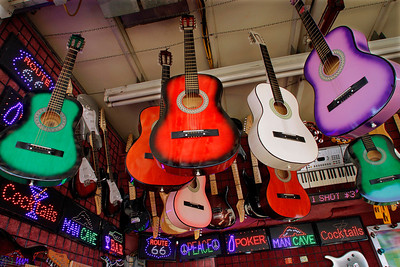 A colorful assortment of guitars are seen in a gaming booth at the Illinois State Fair. (AP Photo/Seth Perlman)