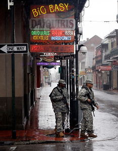 Members of the Army National Guard patrol Bourbon Street in the French Quarter as Hurricane Isaac makes landfall, Wednesday, Aug. 29, 2012, in New Orleans, La.  Isaac was packing 80 mph winds, making it a Category 1 hurricane. It came ashore early Tuesday near the mouth of the Mississippi River, driving a wall of water nearly 11 feet high inland and soaking a neck of land that stretches into the Gulf. (AP Photo/Eric Gay)