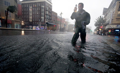 A research student from the the University of Alabama measures wind speeds as Hurricane Isaac makes landfall, Wednesday, Aug. 29, 2012, in New Orleans, La.  Isaac was packing 80 mph winds, making it a Category 1 hurricane. It came ashore early Tuesday near the mouth of the Mississippi River, driving a wall of water nearly 11 feet high inland and soaking a neck of land that stretches into the Gulf. The storm stalled for several hours before resuming a slow trek inland, and forecasters said that was in keeping with the its erratic history. The slow motion over land means Isaac could be a major soaker, dumping up to 20 inches of rain in some areas. (AP Photo/Eric Gay)