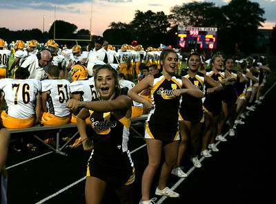 H. Rick Bamman - hbamman@shawmedia.com Jacobs cheerleaders perform following the team's first touchdown in the first quarter.