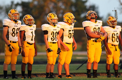 H. Rick Bamman - hbamman@shawmedia.com Jacobs players stand ready prior to the start of the game against Marmion in Aurora.