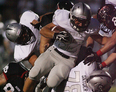 Don Lansu / For the Northwest Herald .Kaneland running back Nate  Dyer (32) struggles through the Huntley Red Raider defense for a 7 yd. gain during action  at Huntley.