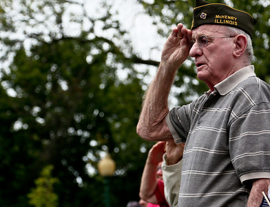 "Josh Peckler - Jpeckler@shawmedia.com World War II veteran Bill Abbink of Crystal Lake salutes the American flag during a ""Keep The Spirit of '45 Alive"" Day event held at Veterans Memorial Park in Mchenry Sunday, August 12, 2012. The event honored World War II veterans who live in the Mchenry County area."