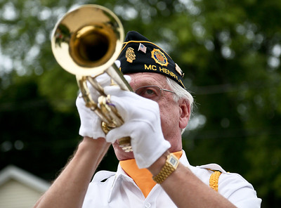"Josh Peckler - Jpeckler@shawmedia.com Ron Bykowski of Mchenry performs ""Taps"" on a trumpet during a ""Keep The Spirit of '45 Alive"" Day event held at Veterans Memorial Park in Mchenry Sunday, August 12, 2012. The event honored World War II veterans who live in the Mchenry County area."