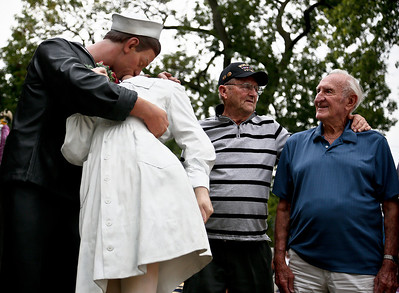 "Josh Peckler - Jpeckler@shawmedia.com World War II veterans Leo Carvis of Woodstock (left) and John Babut of Mchenry look at the ""Kiss Seen Around The World"" statue after helping unveil it during a Keep The Spirit of '45 Alive"" Day event held at Veterans Memorial Park in Mchenry Sunday, August 12, 2012. The event honored World War II veterans who live in the Mchenry County area."