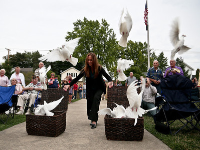 "Josh Peckler - Jpeckler@shawmedia.com Owner of White Dove Release Michaleen Nikolich releases doves during a Keep The Spirit of '45 Alive"" Day event held at Veterans Memorial Park in Mchenry Sunday, August 12, 2012. The event honored World War II veterans who live in the Mchenry County area."