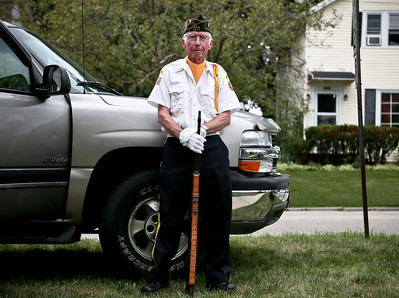 "Josh Peckler - Jpeckler@shawmedia.com Korean War veteran Charles Mathey of Woodstock leans against a truck with his rifle as he waits for the start of a ""Keep The Spirit of '45 Alive"" Day event held at Veterans Memorial Park in Mchenry Sunday, August 12, 2012. The event honored World War II veterans who live in the Mchenry County area."