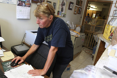 Mike Greene - mgreene@shawmedia.com Vanessa Everett, co-owner of Lucky-E Kennel, works making arrangements for the 103 animals recently received in a shipment from Louisiana that were displaced by Hurricane Isaac Thurday, August 30, 2012 at the kennel in Ringwood. Everett and her staff were contacted Sunday about taking the animals in and received a shipment from Loving Friends Transport Tuesday with the animals.