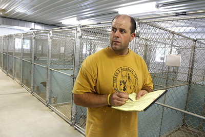 Mike Greene - mgreene@shawmedia.com Carl Curry, of Lakemoor, performs a roll call on animals displaced by Hurricane Isaac which were taken in by Lucky-E Kennel Thurday, August 30, 2012 in Ringwood. The kennel is currently looking for support boarding some of the animals as well as donations to help aid their efforts.