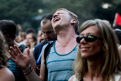 Sarah Nader - snader@shawmedia.com A fan sings along while listening to Dawes perform during day one of Lollapalooza held at Grant Park in Chicago on Friday, August 3, 2012.