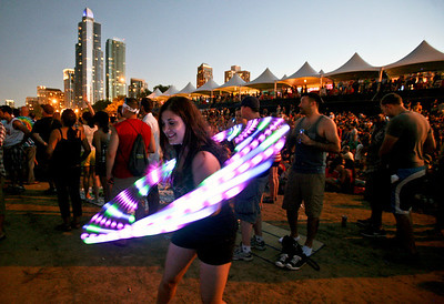 Sarah Nader - snader@shawmedia.com A fan twirls a light while listening to Jack While perform during day three of Lollapalooza in Chicago on Sunday, August 5, 2012.