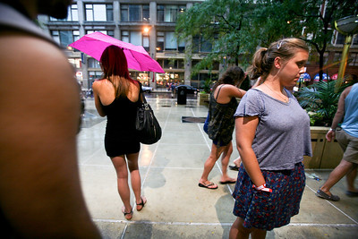 Sarah Nader - snader@shawmedia.com Concert goers where forced to the streets of Chicago after a thunder storm hit Chicago and forced Lollapalooza to delay day two of the three day music festival on Saturday, August 4, 2012.