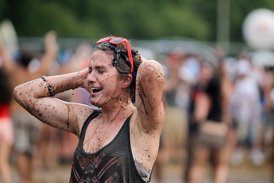 Sarah Nader - snader@shawmedia.com Concert goers play in the mud after a rain storm flooded Grant Park  during day two at Lollapalooza in Chicago on Saturday, August 4, 2012.