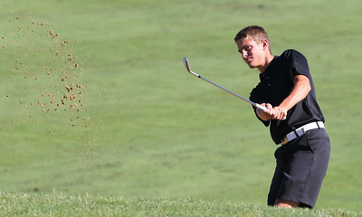 Mike Greene - mgreene@shawmedia.com Austin Wiggerman watches his shot out of a bunker on the 6th hole during the MCJGA Oak Grove Open Monday, August 6, 2012 at Oak Grove Golf Course in Harvard.