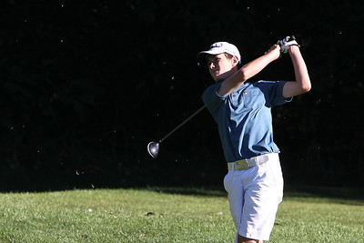 Mike Greene - mgreene@shawmedia.com Grass flies in the air after a drive by Josh Haskins during the MCJGA Oak Grove Open Monday, August 6, 2012 at Oak Grove Golf Course in Harvard.