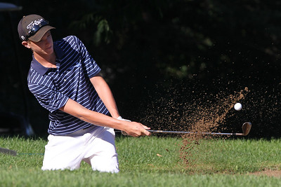 Mike Greene - mgreene@shawmedia.com Hunter Simonini hits out of a bunker on the 11th hole during the MCJGA Oak Grove Open Monday, August 6, 2012 at Oak Grove Golf Course in Harvard. Simonini shot a 82 on the day, earning him a tie for fourth place in the boys junior division.