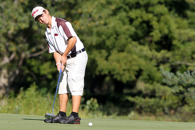 Mike Greene - mgreene@shawmedia.com Jake Bowser watches hit putt roll towards the hole during the MCJGA Oak Grove Open Monday, August 6, 2012 at Oak Grove Golf Course in Harvard. Bowser shot a 78 on the day, earning him third place in the boys junior division.
