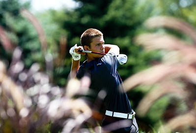 Josh Peckler - Jpeckler@shawmedia.com Austin Wiggerman tees off from the 1st hole during the McHenry County Junior Golf Association Tournament of Champions at Woodstock Country Club Tuesday, August 7, 2012.