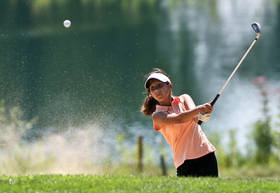 Josh Peckler - Jpeckler@shawmedia.com Josie Kurosky hits her ball out of the sand track on the 3rd hole during the McHenry County Junior Golf Association Tournament of Champions at Woodstock Country Club Tuesday, August 7, 2012.