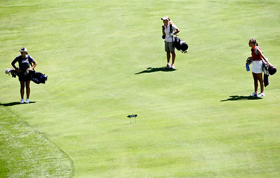 Josh Peckler - Jpeckler@shawmedia.com From left, 	Danielle Roulo, Kaylee Ross and Delainey Peterson walk down the fairway of the 1st hole during the McHenry County Junior Golf Association Tournament of Champions at Woodstock Country Club Tuesday, August 7, 2012.