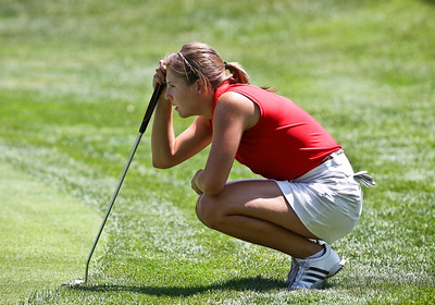 Josh Peckler - Jpeckler@shawmedia.com Delainey Peterson checks the green on the 1st hole during the McHenry County Junior Golf Association Tournament of Champions at Woodstock Country Club Tuesday, August 7, 2012.