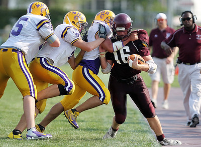 Sarah Nader - snader@shawmedia.com Three Mendota players join forces to push Marengo's John Lesiak out of bounds during the second quarter of Saturday's football game in Marengo on August 25, 2012. Marengo won, 21-7.     .