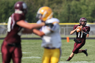 Sarah Nader - snader@shawmedia.com Marengo's quarterback Christopher Lopez throws a pass during the first quarter of Saturday's game against Mendota in Marengo on August 25, 2012. Marengo won, 21-7.