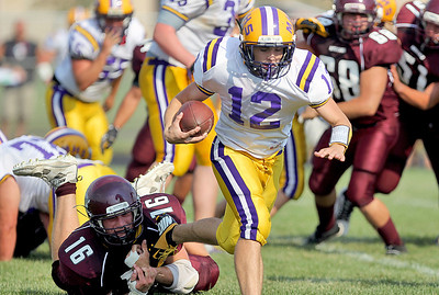 Sarah Nader - snader@shawmedia.com Marengo's John Lesiak (left) holds onto Mendota's Jack Buchanan  during the second quarter of Saturday's football game in Marengo on August 25, 2012. Marengo won, 21-7.