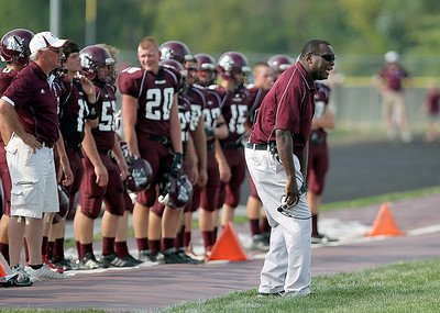 Sarah Nader - snader@shawmedia.com Marengo's head coach Matthew Lynch watches Saturday's football game against Mendota in Marengo on August 25, 2012. Marengo won, 21-7.