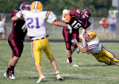 Sarah Nader - snader@shawmedia.com Mendota's Trea Blumhorst (right) tackles Marengo's John Lesiak after he gains eight yards in the first quarter of Saturday's game in Marengo on August 25, 2012. Marengo won, 21-7.