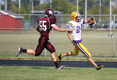 Sarah Nader - snader@shawmedia.com Marengo's Tommy Graczyk (left) tries to tackle Mendota's Wyatt Martinson while he scores a touchdown during the first  quarter of Saturday's football game in Marengo on August 25, 2012. Marengo won, 21-7.
