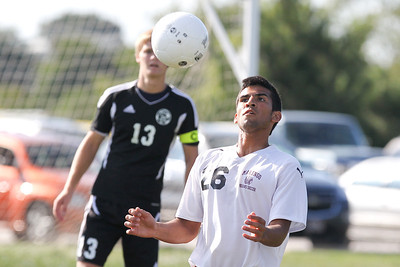 Mike Greene - mgreene@shawmedia.com Marengo's Ryan Vega-Perez watches a ball into his chest during a game against Kaneland Tuesday, August 21, 2012 at Marengo High School. Kaneland defeated Marengo 4-1.